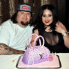 Chumlee and his Lady Faire pose with a pink pocketbook and her new boobs.