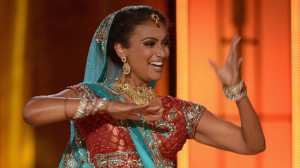 The new Miss America in her homelands traditional garb, using hand signals to tell other terrorists about the next plot on National television.